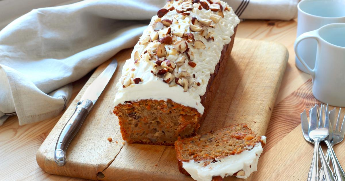 Add shredded carrot, walnuts and raisins and mix by hand. Pour batter into a 13x9-inch baking pan that has been generously greased with shortening. Bake for 55 to 60 minutes or until a toothpick stuck in the center comes out clean. Allow the cake to cool completely.