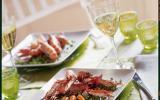 Langoustines sautées à l'huile d'olive et poivre saveur flambées au pastis, sur un lit de petits pois et carottes et son jus