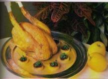 Chapon rôti aux pommes et au boudin noir