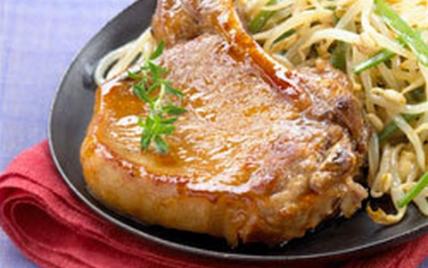 Côtes de porc laquées au miel - Photo par Le Porc