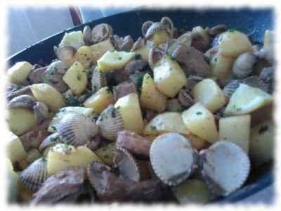 Carne de porco à alentejana - Photo par sofiad