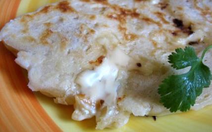 Naan au fromage ou cheese-naan - Photo par ottoki