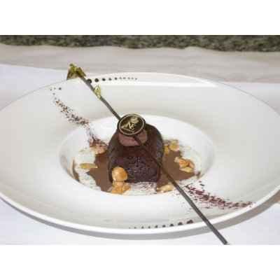 Baba chocolat au rhum brun, velouté de chocolat et crème mousseuse - Photo par 750g