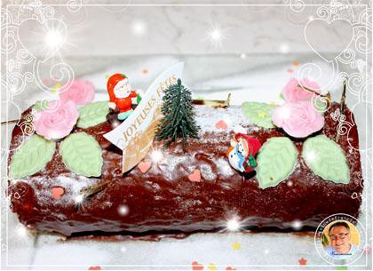 Bûche de noel au chocolat et pistache - Photo par francis51